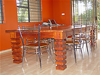 Designer dining Furniture for restautants and home. Rhodesian teak dining room tables and matching chairs (Wood leather) through uniche furniture, south africa.